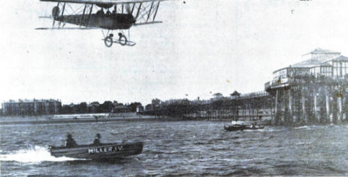 An aeroplane, from the Lancashire School of Aviation at Squires Gate, flying over Lytham Pier in 1930.