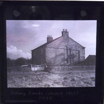 Glass slide of what appears to be a farm, dating from 1934 it is entitled 'Pilling Sands dated 1815.'
