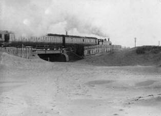 Sand drifts along the railway at Blackpool in 1914.