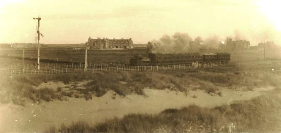Train leaving St.Annes for Blackpool c1883. The photographer is stood near the present-day Fire Station in St.Andrew's Road North. Houses in the distance are: Church Road (left) St.Annes Road East (centre) and St.David's Road South (right).