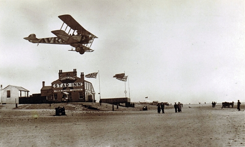 An AVRO Aircraft flying over the Star Inn, South Shore, Blackpool, 1919.