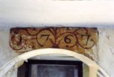 "The date of construction ( or reconstruction) ""1767"" painted above a door (photo taken in 1989."