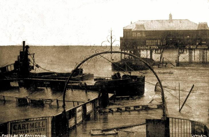 Lytham Pier cut through by barges during a storm in 1903.
