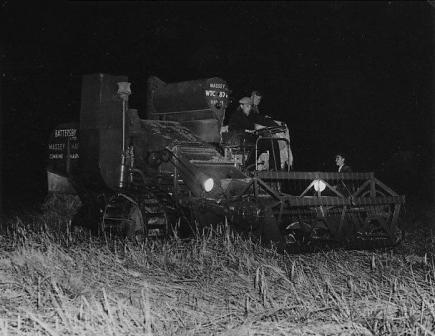 Two photos of harvesting by floodlight, Peel Hall Farm 1956.