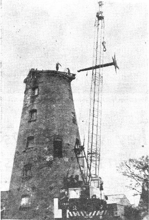 A 90 ft jib crane removing the sail shaft from the 65ft, old Pilling mill which is to be converted into a private house by a Bradford businessman.