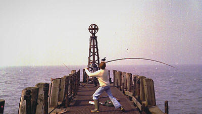 Fishing on the jetty, St.Annes Pier, in the 1980s.