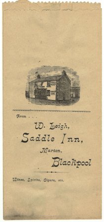 A paper bag used for spirits sold at The Saddle to drink off the premises c1900. William Leigh was landlord of the Saddle Inn from 1892. The building was extended in 1924. His wife, Elizabeth, was still there in 1942.