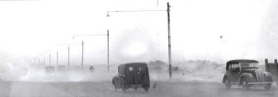 The age-old problem of blowing sand, seen here drifting across Clifton Drive, St.Annes, in 1952.