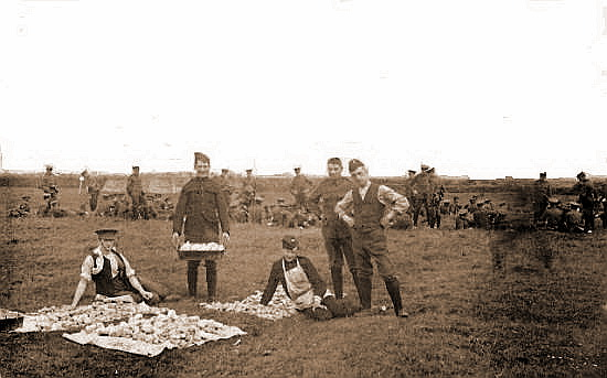 Photograph taken at the army camp at Squires Gate in 1907; Soldiers preparing potatoes.