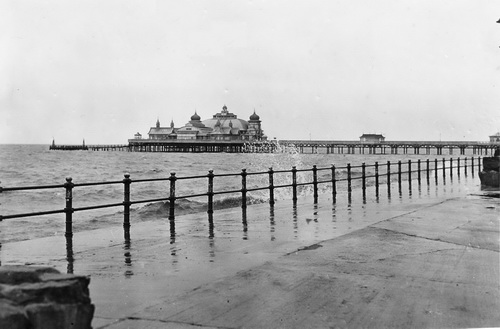 Photograph of a high tide with the waves lapping the Outer Promenade, St.Annes-on-the-Sea in February 1956.