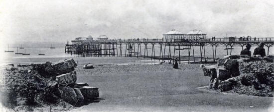 Two shops under construction half-way along the deck, 1898.