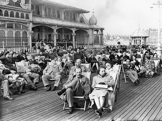 Well wrapped up sunbathers on St.Annes pier in the 1950s.