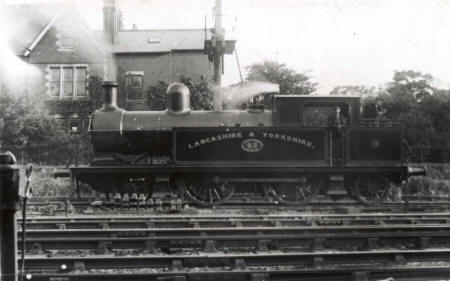 Locomotive in the sidings at Lytham c1920. The house behind is