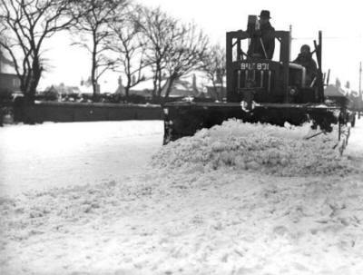 Tractor clearing snow from Clifton Drive, St.Annes, 1940.