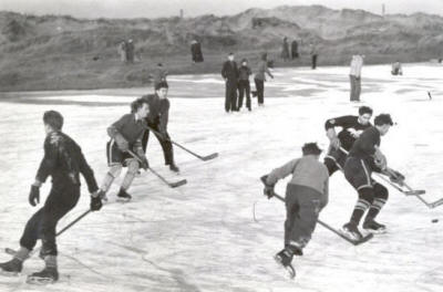Playing Ice hockey in the sand dunes, Fairhaven, January 1952.