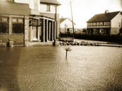The flooded garden of a house on the corner of Clifton Drive and Highbury Road (now a nursing home).