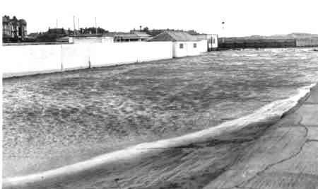 Car park at Open Air Baths, St.Annes, flooded by a high tide, December 1951.