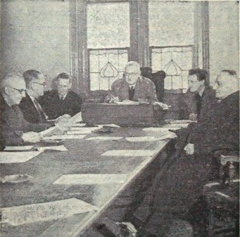 The Baths Committee meeting at Blackpool Town Hall, mid-February, 1947. There was no heating so members had to keep their overcoats on and get on with the business. Pictured are Ald. J.R.Quayle,J.P., Coun.F.R.Boydell, Mr.J.H.Hollingworth, Coun.W.Ogden, MrJ.Bell and Coun.A.Dyson.