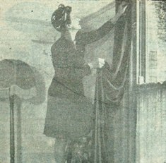 A boarding house in Warley Road, Blackpool, mid-March 1947. Mrs.A.Coleclough hangs her curtains again after a thorough clean, in readiness for Easter visitors.