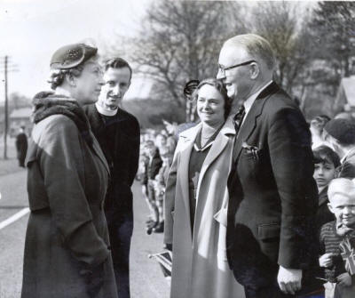 Princess Margaret speaking with the vicar, Rev Walsh, Mrs Lyon and the headmaster, Mr.Lyon.